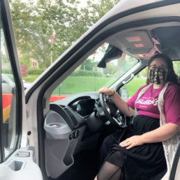 Lianna Tagle, Educational Outreach Coordinator at GRCM, in driver's seat.
